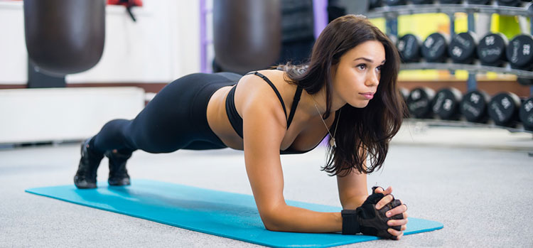 portrait fitness training athletic sporty woman doing plank exer